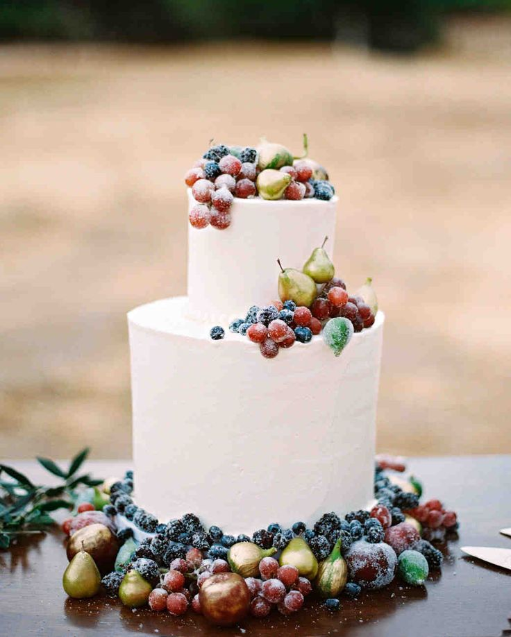 A Fruit-Filled, Floral California Wedding | Martha Stewart Weddings - The buttercream-frosted wedding cake, one of three, was adorned with sugar-coated grapes and berries as well as gold-dusted pears and figs.