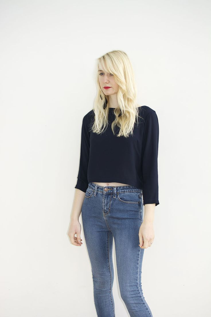 Long 3/4 length navy sleeve crop top with high neck, made from a soft high quality viscose fabric. A wardrobe staple, perfect teamed with high waisted jeans or printed trousers, day or night. Made to order in the UK. 100% Viscose.