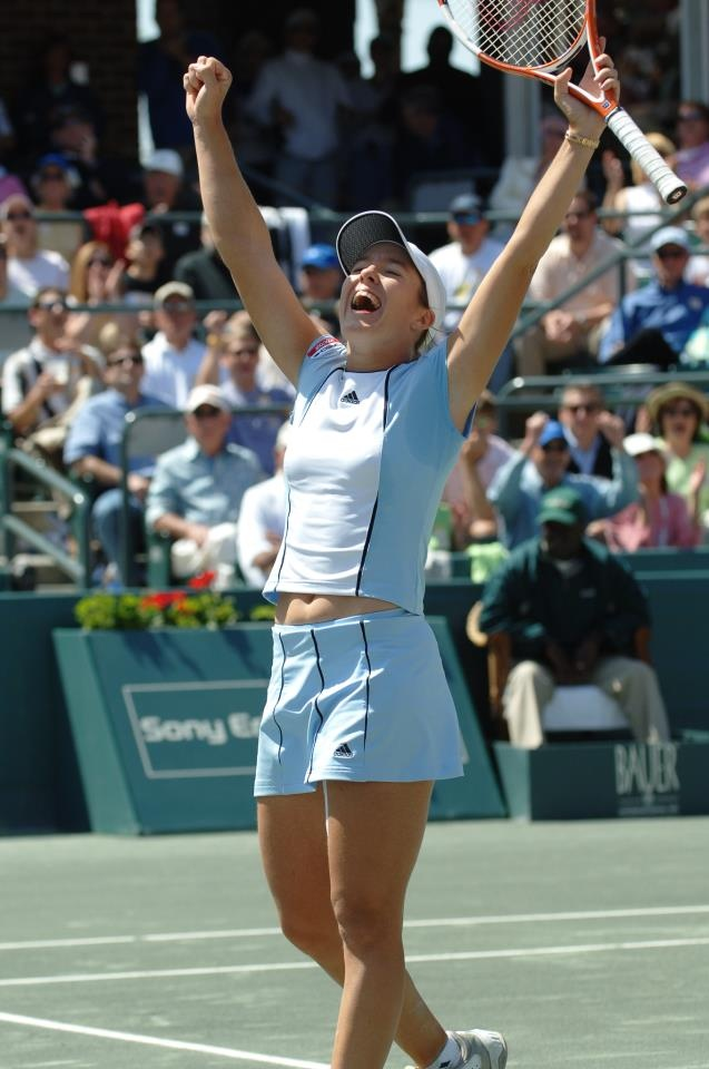 Justin Henin celebrates after she defeated Elena Dementieva to win her second FCC title in 2005