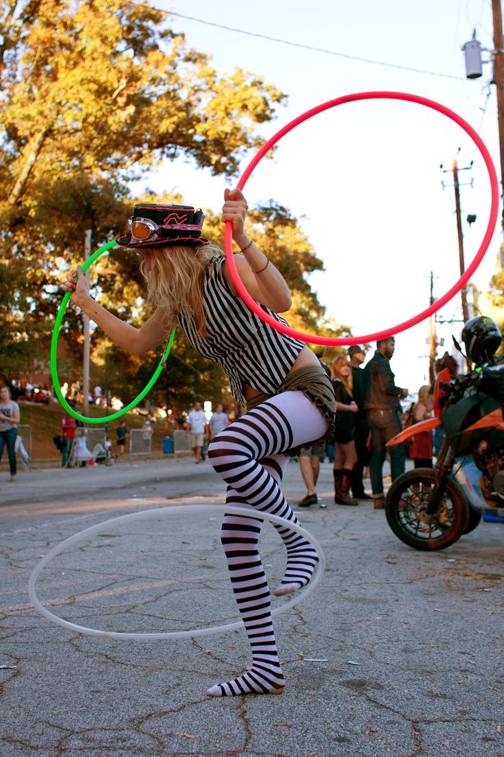 ...and I just reallly like this photo (: http://tutta.hubpages.com/hub/hula-hoop-tricks