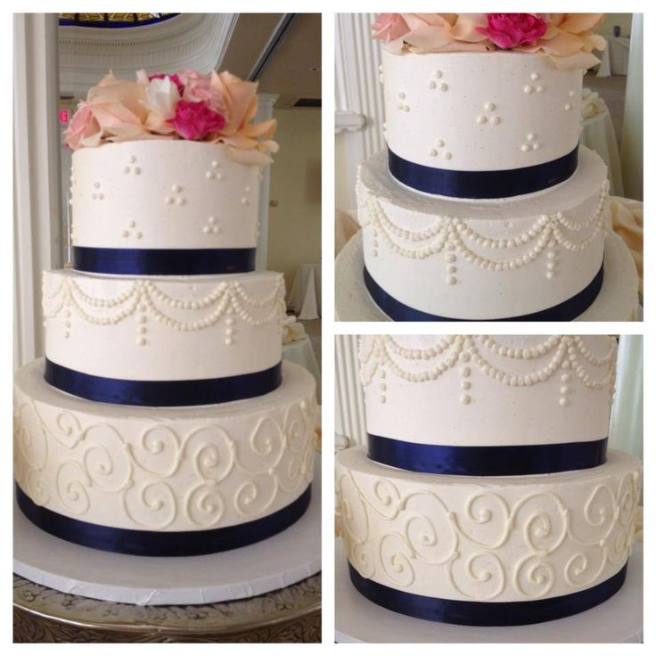Elegant wedding cake. Buttercream and fresh flower three tier wedding cake. Tri dots, buttercream swags, and scrolls wedding cake. Navy blue and pink fresh flowers.  Sugar and Spice Specialty Desserts, Sacramento, CA http://www.sugarandspice.me