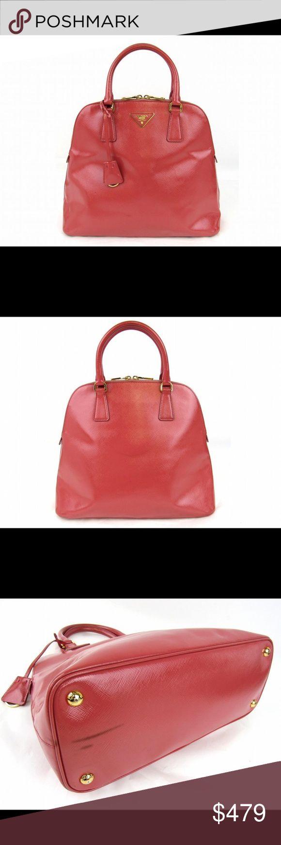 "Authentic PRADA Handbag Tote Bag Saffiano Leather Brand NamePRADA  Item NameHandbag  ColorPink  MaterialSaffiano Leather  SizeW33 x H27 x D13cm(W12.9"" x H10.6"" x D5.1"")     Handle:32cm(12.5"")Strap drop:10cm(3.9"")  Pocket>Inside/Open x 3/Zipper x 1  Some noticeable wrinkles/Metal part has a few noticeable scratches  Metal part has a few noticeable stains  Edges/RimSome noticeable scratched  Signs of wearSigns of wear prada Bags Totes"