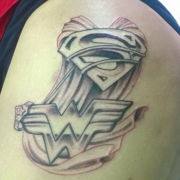 Wow, this a badass looking Superman & Wonder Woman tattoo!via Wonder Woman Tattoo Appreciation Page's photo.