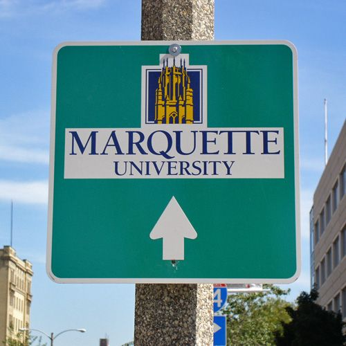 Marquette University road sign, posted during the Marquette Interchange reconstruction in 2004.