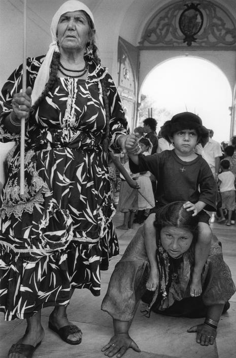 Greek island of Tinos attracts pilgrims to see and touch the miraculous healing icon of the Virgin Mary, that was found in 1822 - thousands of Greeks Orthodox believers walk on their knees from the harbour to the church of Panagia Evangelistra to ask for the protection and favours of the Virgin. — at Τήνος - Tinos island, Greece.