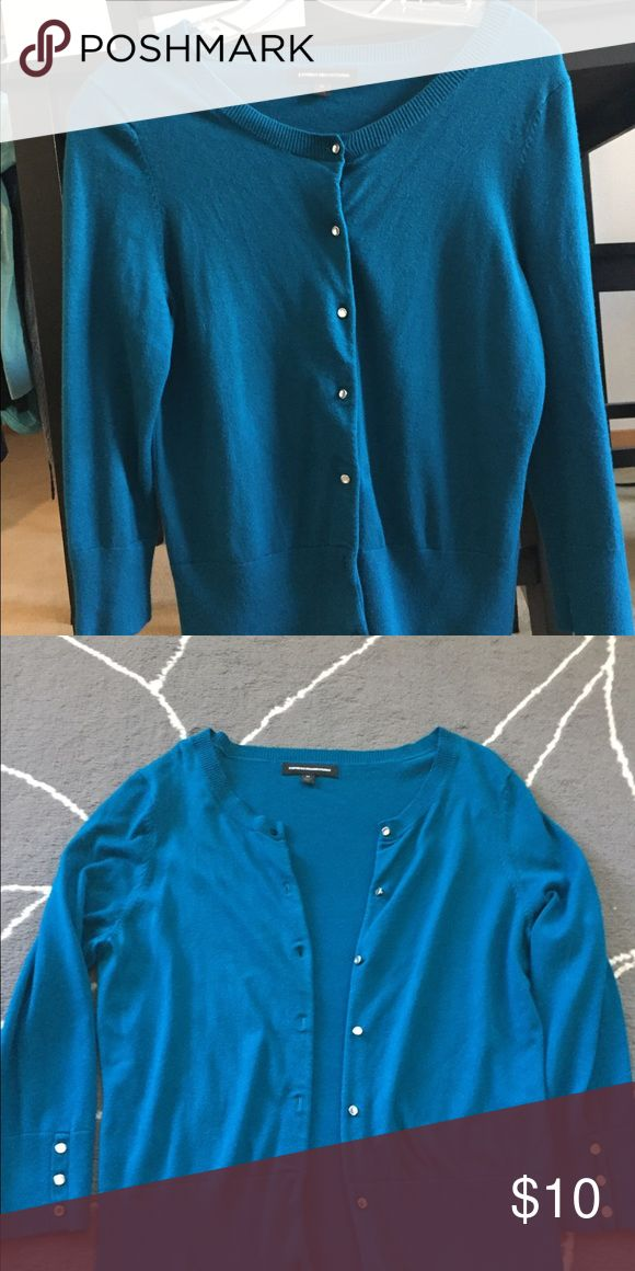 Express teal cardigan with diamond style buttons Never worn. Express teal cardigan with diamond style buttons. Size medium. 80% rayon, 17% nylon, 3% spandex. Express Sweaters Cardigans