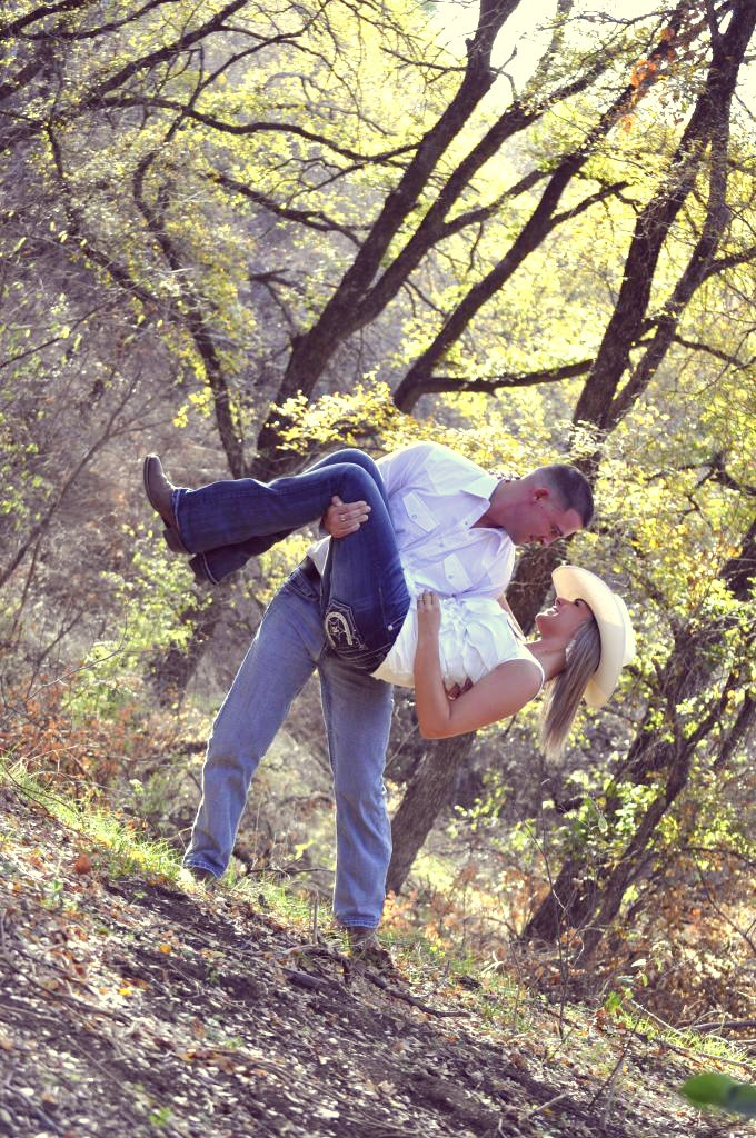 Country Engagement Pictures.  Kick one leg up, and have his hat on..Hope Floats pic