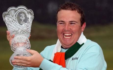 Triumphant: Shane Lowry clutches the trophy after winning The 3 Irish Open