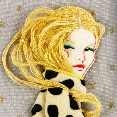 Paula Sanz Caballero.  the use of wool to portray the hair creates a boldness and movement that I feel creates the piece to be eye catching and seductive.