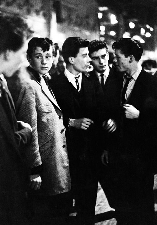 A group of teddy boys enjoy an evening out at the Mecca Dance Hall in Tottenham, London, 29th May 1954.
