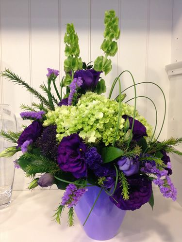 Fresh Flower Arrangement - Designed in a beautiful ceramic container, this one sided arrangement is the perfect gift for the office or a side table. Consisting of long lasting seasonal mixed flowers, green Hydrangea, Fugi Mums, and Lisianthus.