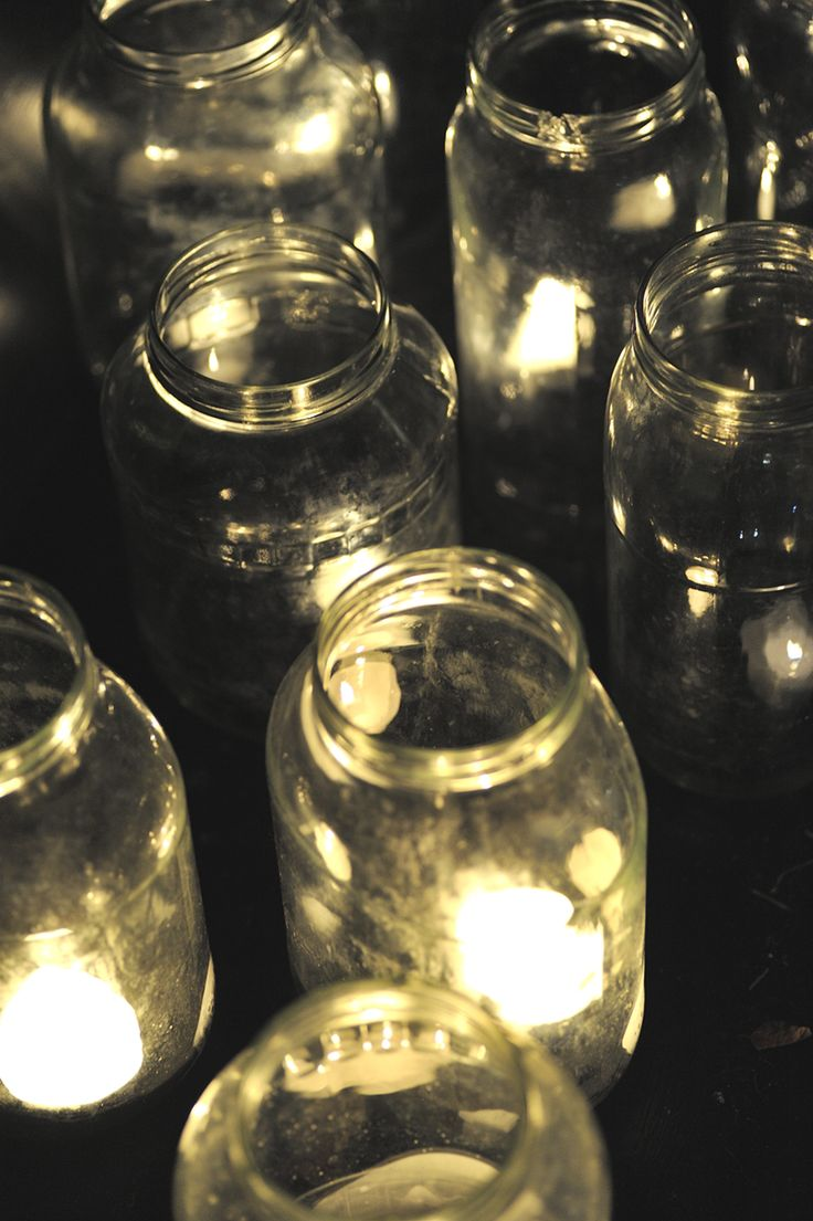 Empty jars with small candles make the cold evening cozy.