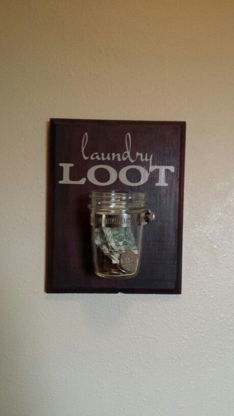Laundry Loot Laundry room sign... All you need is a small Mason jar, some vinyl lettering (I used the cricut), acrylic paints of your choice (I used a black base and worked some maroon into it), a hose clamp, and a small piece of half inch thick wood that could be found at most craft stores- like Hobby Lobby.