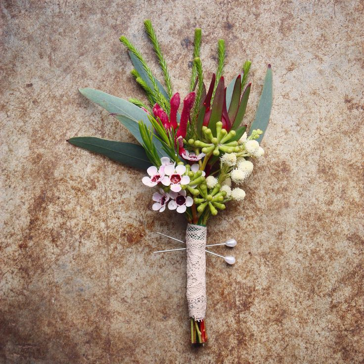 Native boutonniere with seeded eucalyptus, wax flower, kangaroo paw and Leucadendron by Swallows Nest Farm