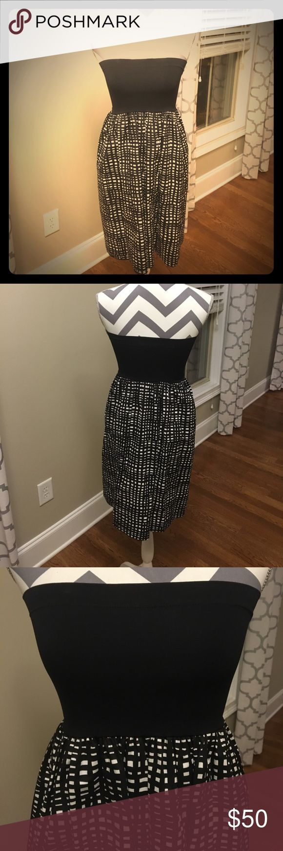 Theory black and white tube top dress, one size Theory black and white tube top dress, one size fits all. Top portion is a soft spandex material, bottom is a woven fabric. Can dress up or down, very versatile piece. You can also wear this as a skirt, 2-in-1! Gently loved and in good condition, one small place where stitching has come undone (shown in last picture). Theory Dresses Strapless