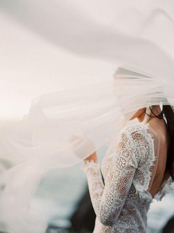 Romantic Long Sleeve Lace Wedding Dress with an Open Back | Erich McVey Photography | http://heyweddinglady.com/bohemian-coastal-wedding-palette-cobalt-blue-fuchsia-pink/