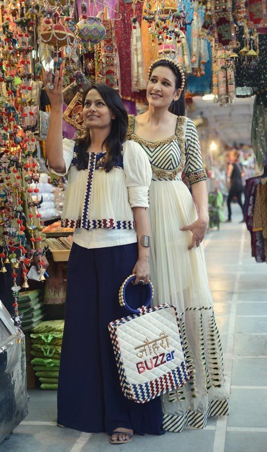 Love this loose white top with border: Pallavi Jaipur with a model