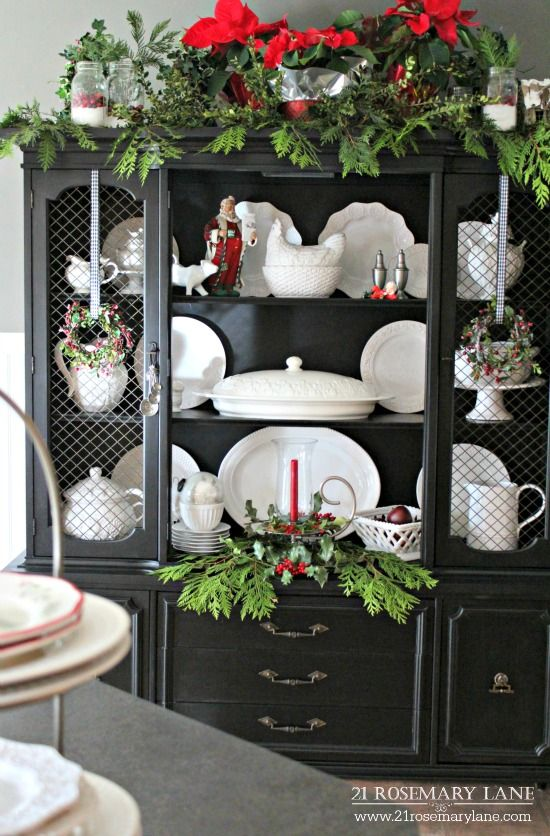 Hutch painted black, center doors removed, displays white ironstone and…