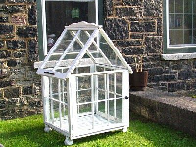 "Mini greenhouse made from old windows. I like the ""feet"" on it."