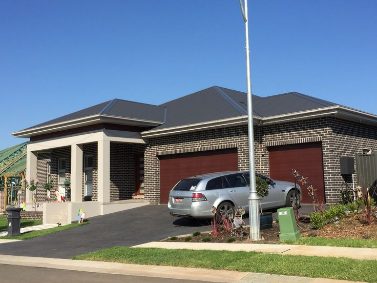 Blackbutt bricks, dune render, monument roof