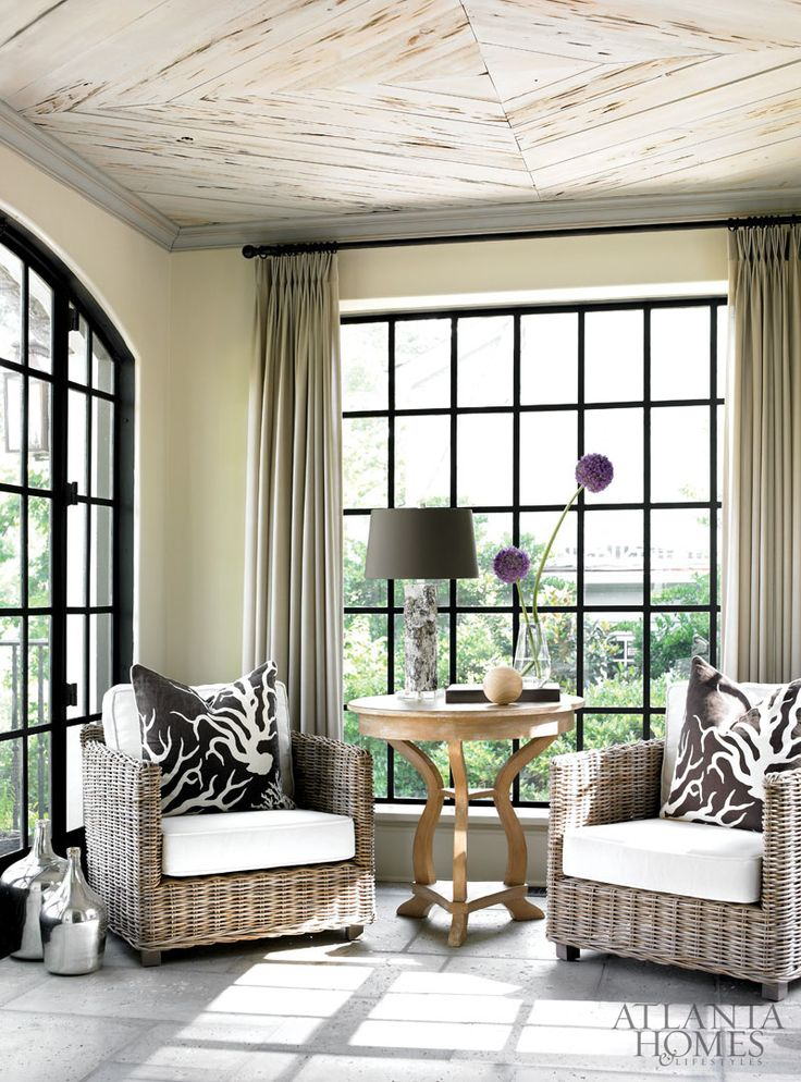 In the sunroom, custom windows by Mike Hammersmith, Inc., wrap the light-filled space. Wonderful  Wood Ceiling Detail...