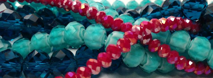 Faceted cut glass   teal, aqua and rose red
