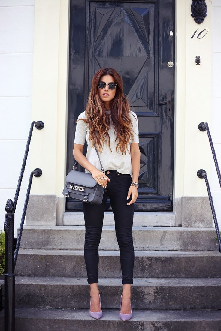 Negin Mirsalehi, wearing a top from Karen Millen, black jeans, pink shoes from Gianvito Rossi and a grey bag from Prouza Schouler. Hair inspiration too!