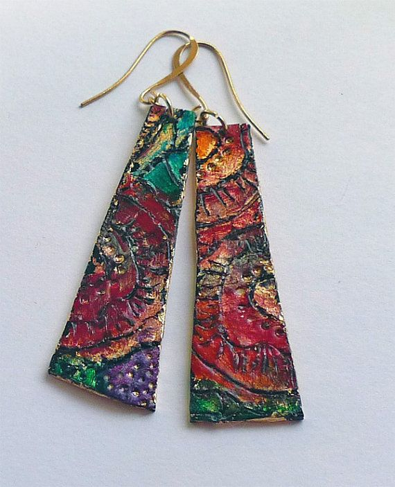 A moss rose by any other name is still a rose. (A nod to Gertrude Stein) Rich jewel colors and elegant slim design, this handmade pair of carved earrings is sure to delight. In addition to carving freehand designs into the polymer clay, Ive used gold leaf, alcohol inks, several curings