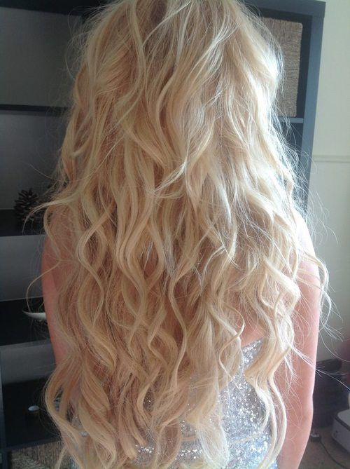 Natural curls with saltwater: Get a spray bottle & fill half with water. Pour 4 table spoons of salt into it & shake. Fill the rest with water & shake again. Spray into hair until damp. Apply hair spray & braid hair into 2 or 3 big tight braids, then sleep on it.