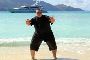 Kim Dotcom, Megaupload CEO, doing the Hammer Time before a yacht.