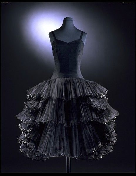 Balmain | c. 1957    This cocktail dress, designed for the increasing elegant youth of the late 1950s is inspired by ballet and Spanish flamenco dress. It epitomises Balmain's harmonious balance between extravagance and elegance.