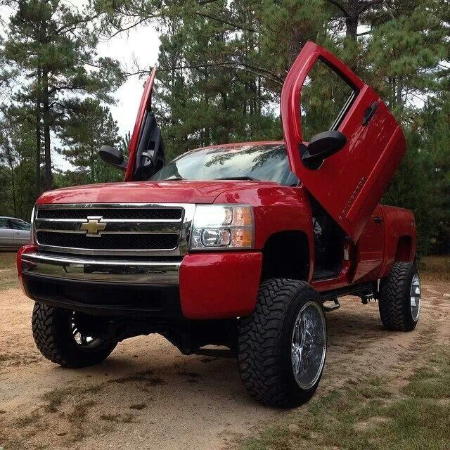 red lifted Chevrolet C...