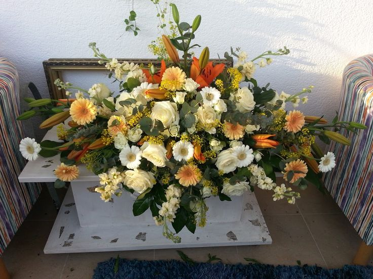 enormous flower arrangement with lilies, germini, roses, spray, mathiola and eucalypthus.