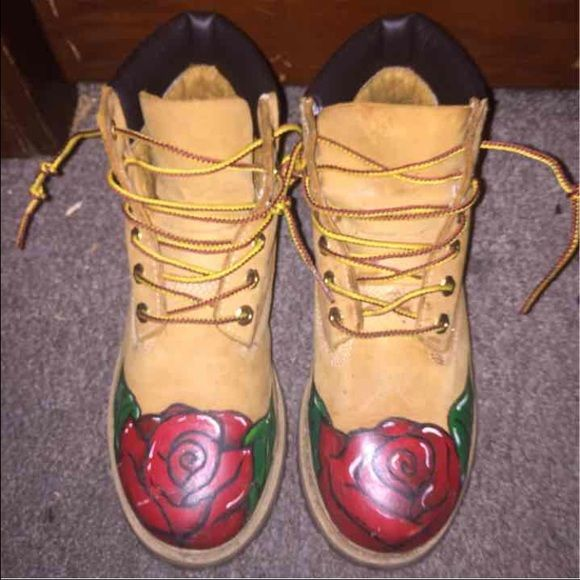 Custom made timberlands rose designs Rose designs with Rastafarian flag colors on the tree. Size3y but fits women's 5-6.5 when soles are removed.  Will clean. $200 OBO Timberland Shoes Winter & Rain Boots