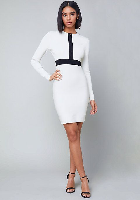 Not-so-subtle colorblock dress in a long-sleeve, open-back design. Bandage-style fabric hugs curves. Undo front zip a little to flash some cleavage or all the way to create a plunge look. Start out the day a bit conservative and end the evening with a ba-boom!  Khloe Open Back Dress by bebe
