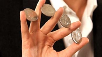 Coins between the fingers. PIN IT! http://www.magictricksreviewed.com/learn-easy-magic-tricks-with-coins #magic coin tricks #tricks with coins #magic tricks #magic #coin tricks #magician #learn magic #beginners magic