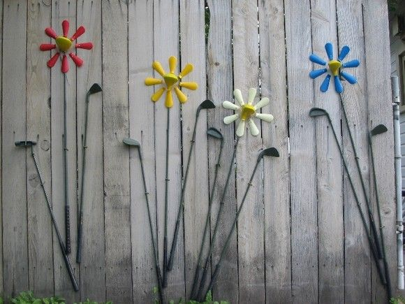 Golf clubs and shoe horns make up this flower garden                                                                                                                                                     More