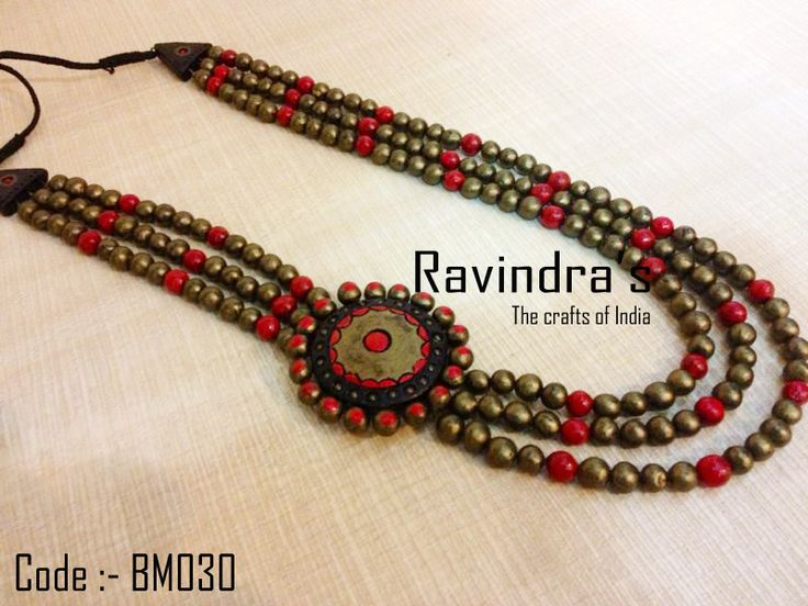 Red, black and gold beaded terracotta necklace with a side pendant.   Visit the link for further details :- https://www.facebook.com/photo.php?fbid=223798637777966=a.223798624444634.1073741826.223796264444870=1