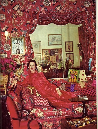 Diana Vreeland at home with her sofa full of bargello cushions
