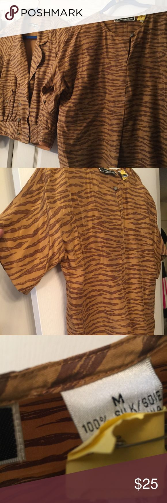 Gilman100%silk animal print short sleeve top 12/14 Part of a gorgeous silk set purchased at Nordstroms separately.. jacket 14/16 matches in photo and a listed size 16 real leather mini skirt  just drycleaned price for short sleeve only Gilman Tops Blouses