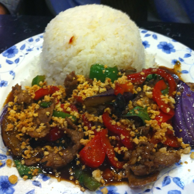 Spicy eggplant over rice - sautéed beef with eggplant, bell pepper, basil and Thai chili served with steamed rice from King of Thai Noodle House