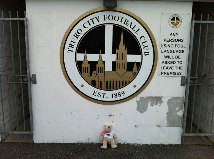 The bus tour has found it's way to Truro City FC.  I have looked for their mascot, but he's not here today, so I'm making do with posing in front of the club badge.  I have learnt a couple of things though. Truro City won their first ever game 7-1 against Penzance on 4th October 1889, and when they won the the F.A. Vase in 2007 at the New Wembley Stadium with a 3-1 win over AFC Totton, it was first time the Trophy had been won by a Club playing at Step 6 in the Football Pyramid. How about…