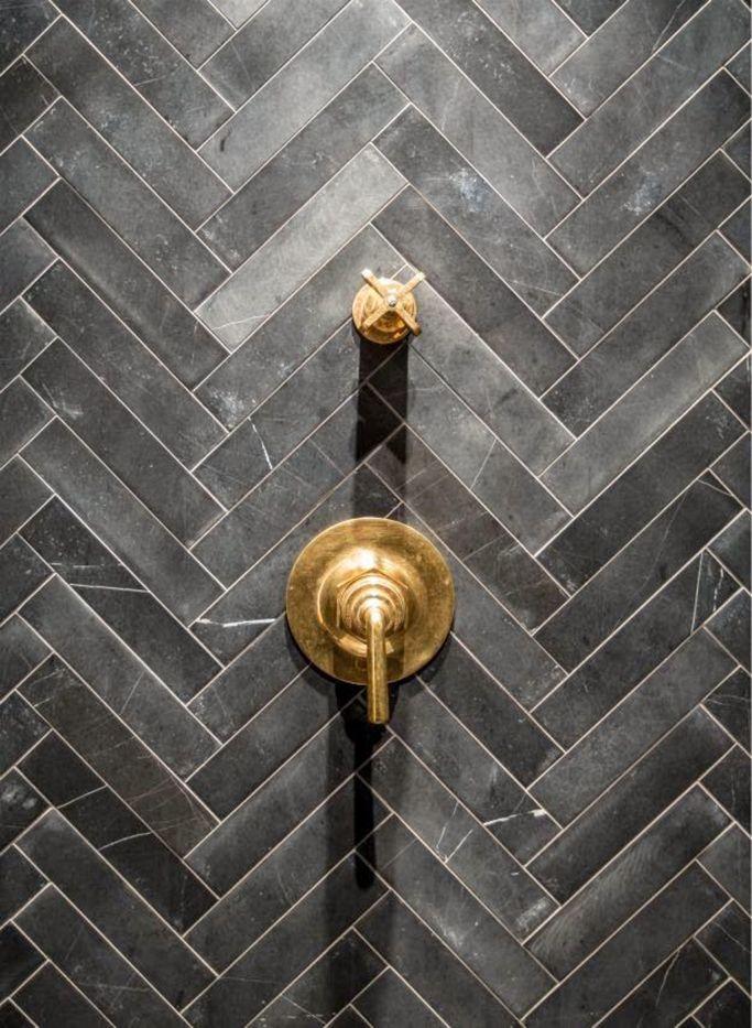 Black metro tiles in herringbone pattern