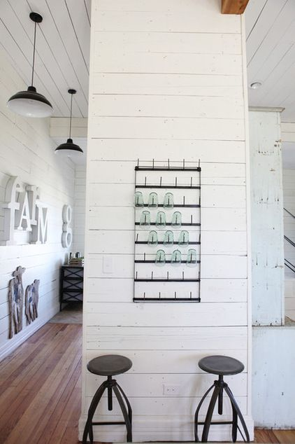 Make displays of useful items instead of spending on decor. Almost anything — a pile of wood, a basket of table linens, a row of coffee mugs, a wall rack of glassware