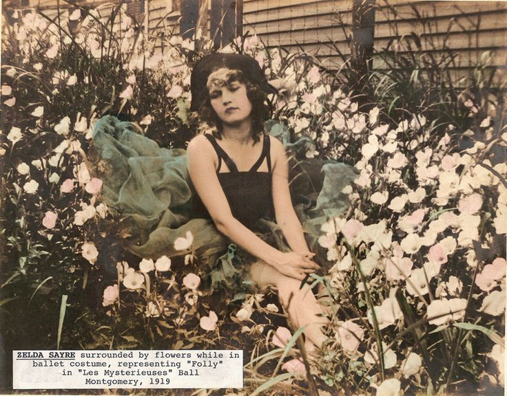 """Zelda Syre, surrounded by flowers while in ballet costume, representing """"Folly"""" in """"Les Mysterieuses"""" Ball, Montgomery, AL, 1919.  Courtesy of the F. Scott and Zelda Fitzgerald Museum"""