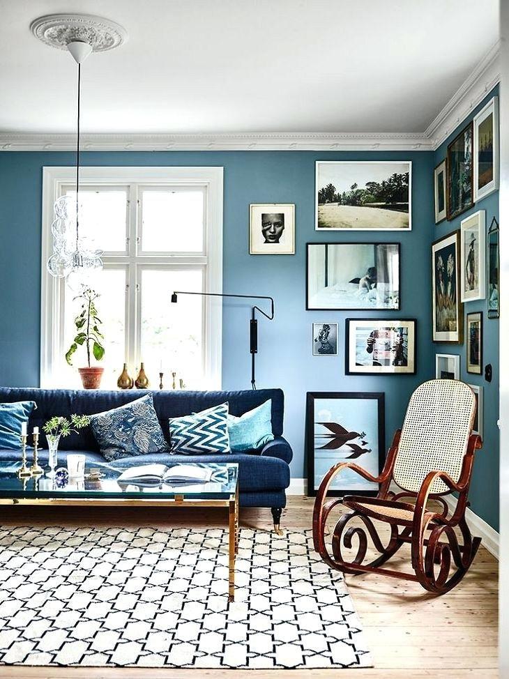 Navy Blue Sofa Against A Very Light Blue Wall Light Blue Walls Blue Family Rooms Blue Rooms