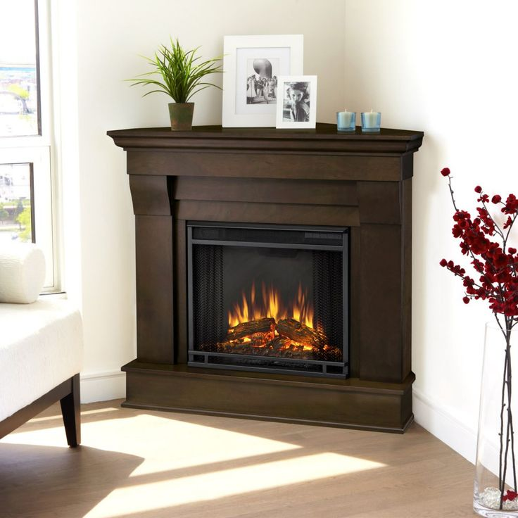 Real Flame Chateau Corner Electric Fireplace - Dark Walnut - The Real Flame Chateau Corner Electric Fireplace - Dark Walnut is a space-saving model that features clean lines, a rich finish, and ultra bri...