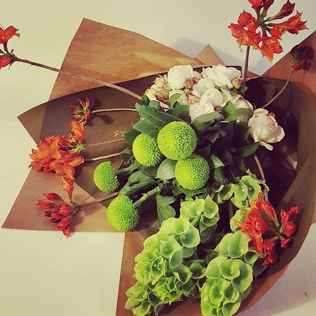 Modern grouped bouquet in Green, Orange and white.