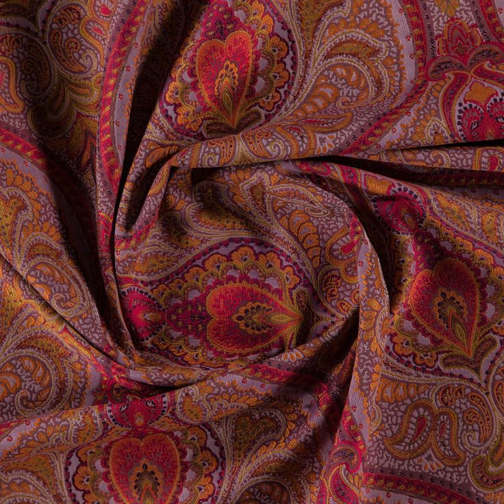 An ornamental jacquard home furnishing fabric available in a red - orange - multicoloured colourway. This article has a synthetic composition, and is suitable for curtains and upholstery use.