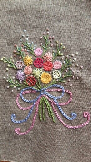 Another pretty floral embroidered design.  Button-hole flowers, lazy daisy stitch and chain stitch flowers.  So Pretty!